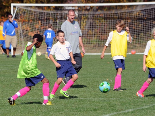 Soccer players affiliated with the Central Delaware Soccer Association practice last year at a field off of Lewis Drive north of Dover. CDSA is the anchor tenant for the planned $24 million Kent County Regional Sports Complex.