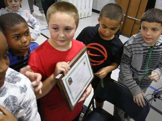 Fifth grader honored for 911 call to save father