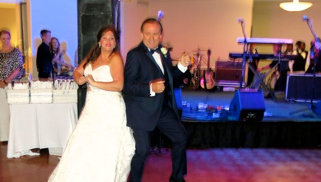 Tiffany Brando dances with her dad, Fox Sports announcer Tim Brando at her wedding reception.