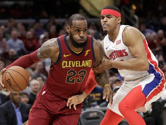 Cleveland Cavaliers' LeBron James (23) drives against Detroit Pistons' Tobias Harris, right, in the first half of an NBA basketball game, Sunday, Jan. 28, 2018, in Cleveland. (AP Photo/Tony Dejak)