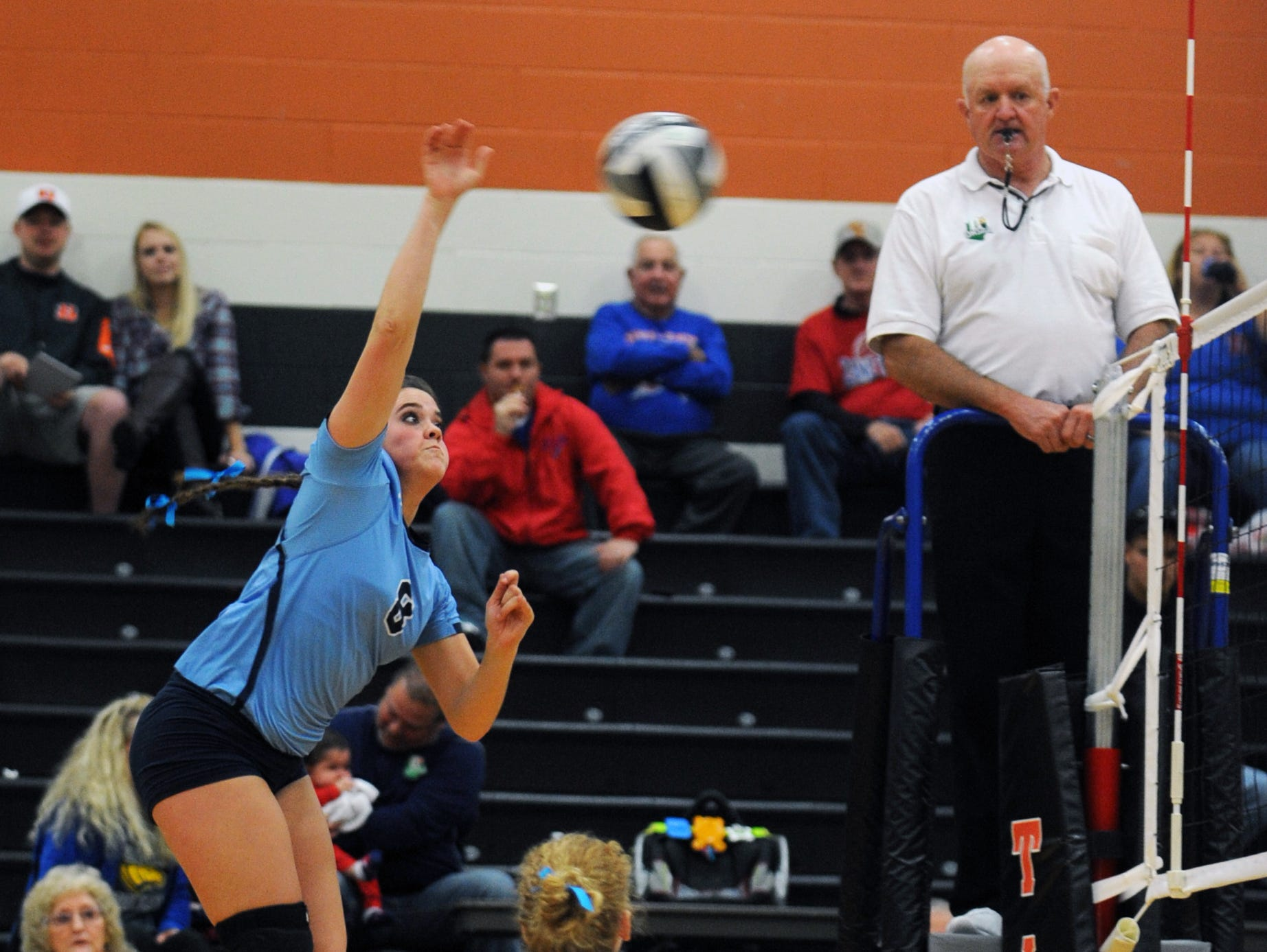 Adena's Devon Putnam hits the ball over the net to South Point opponents Wednesday at Waverly High School. Adena defeated South Point 3-0.