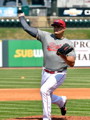 Louisville pitcher Sal Romano participates in fielding practice during the Bats Media Day at Louisville Slugger Field, Wednesday, April 5, 2017 in Louisville.