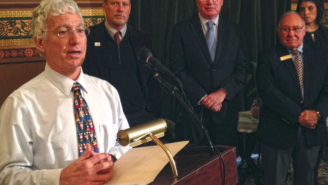 Pediatrician Lou DiNicola, former president of the American Academy of Pediatrics Vermont Chapter, speaks about the need for vaccinations at a news conference Thursday at the Statehouse in Montpelier.