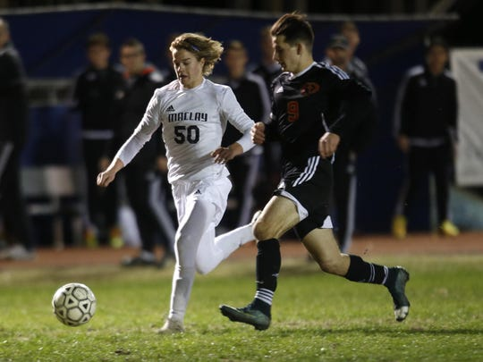 Maclay's Bradley Stager dribbles the ball past Orangewood Christian's Kemper Turner during their Region 1-1A final at Maclay on Friday. Orangewood Christian went on to win, 2-1.