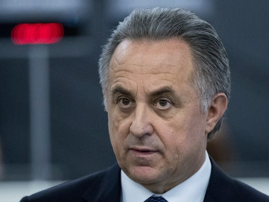FILE In this file photo taken on Thursday, Dec. 7, 2017, Vitaly Mutko, Russian Federation Deputy Prime Minister & Russia 2018 WCup Local Organising Committee Chairman, speaks with press during the opening of the WCup Fan ID distribution center in Moscow, Russia.Vitaly Mutko, a Russian government official who has been dogged by allegations of involvement in doping, has temporarily stepped down as president of the Russian Football Union, a move apparently intended to deflect international criticism as Russia prepares to host the 2018 World Cup. (AP Photo/Pavel Golovkin, File)