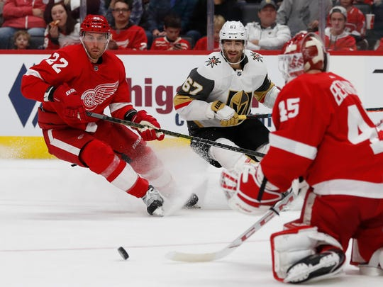 Detroit Red Wings goaltender Jonathan Bernier (45) deflects a shot as defenseman Patrik Nemeth (22) and Vegas Golden Knights left wing Max Pacioretty (67) approach during the second period of an NHL hockey game, Sunday, Nov. 10, 2019, in Detroit. (AP Photo/Carlos Osorio)