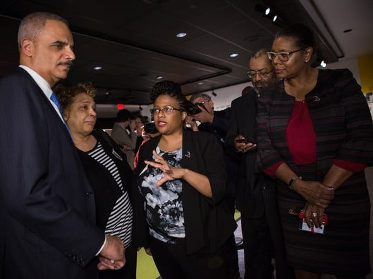 "April 2, 2018 - (Left to right) Eric Holder, former attorney general of the United States, holds Carolyn Payne, sister of Larry Payne, as they listen to Dr. Noelle Trent, director of interpretation, collections and education, and Terri Freeman, while touring the new exhibit, ""MLK50: A Legacy Remembered,"" at the National Civil Rights Museum on Monday. Panye's 16-year-old brother, Larry, was shot and killed by Memphis police following a march led by Dr. Martin Luther King, Jr. on March 28, 1968 in Memphis. The event turned violent and it left Payne dead and 62 people injured."