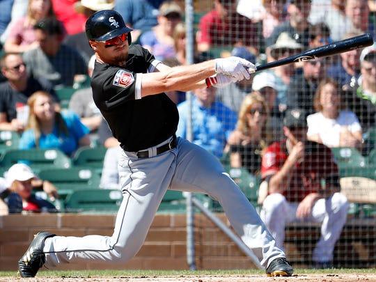 Chicago White Sox's Adam Engel follows through on a two-RBI base hit against the Arizona Diamondbacks during the second inning of a spring training baseball game Monday, March 19, 2018, in Scottsdale, Ariz. (AP Photo/Matt York)