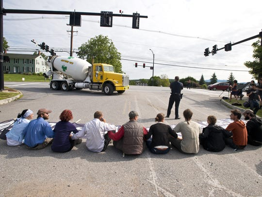 Members of Rising Tide block the entrance to a Vermont Gas construction site in Williston on Wednesday, July 30, 2014. The group opposes a natural gas pipeline expansion in the region.