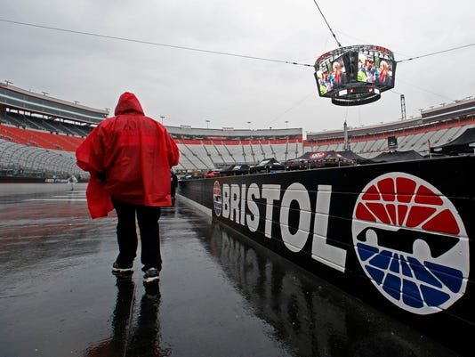 A fan walks along the wall at Bristol Motor Speedway before a NASCAR Monster Energy NASCAR Cup Series auto race, Sunday, April 23, 2017, in Bristol, Tenn. (AP Photo/Wade Payne)