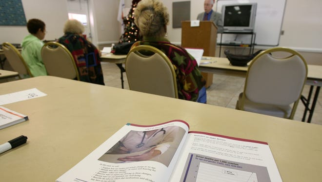 FIle photo of an AARP Driver Safety Program workbook at a refresher class for drivers 50 and older in Orlando.
