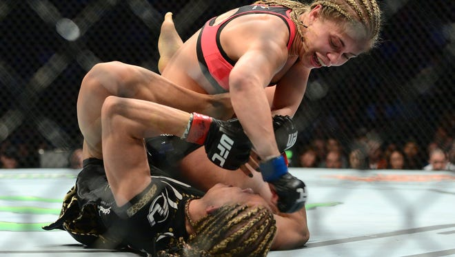 Felice Herrig (red) and Paige VanZant (blue) fight during UFC Fight Night at Prudential Center. VanZant won via unanimous decision.
