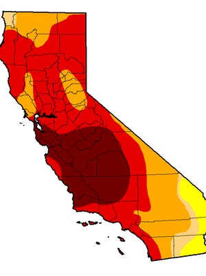 Most of the state of California remains in a drought. The worst levels of drought are shown in dark red, light red and orange.