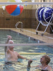 Residents at Royal Oaks Retirement Community in Sun City play water volleyball on Dec. 2.