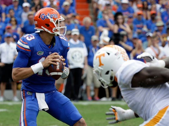 Florida quarterback Feleipe Franks (13) looks for a receiver against Tennessee during the first half of an NCAA college football game, Saturday, Sept. 16, 2017, in Gainesville, Fla. (AP Photo/John Raoux)