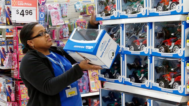 Toy department manager Gayla Harris stocks shelves for Black Friday sales at a Walmart in Oklahoma City in 2013.