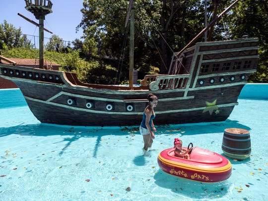 Paige Caldwell, left, slowly follows her one-year-old daughter Paisley Caldwell, right, both visiting town from Tennessee, around the newly renovated Monkey Ship bumper boat area inside Mesker Park Zoo in Evansville, Ind., Saturday, July 7, 2018. Over two decades ago, the famous Mesker Park Zoo attraction used to be home to a live monkey exhibition.