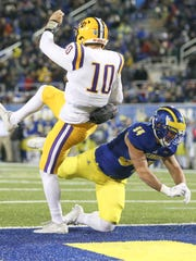Delaware's Christian Lohin blocks a punt attempt by Albany's Neven Sussman in the third quarter of the Blue Hens' 22-3 win at Delaware Stadium Saturday.