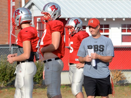 Kyle Shoulders (right) has been hired as football coach at his alma mater Macon County