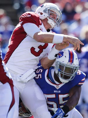 Carson Palmer gets hit by Jerry Hughes of the Buffalo Bills during the first half on Sept. 25, 2016 in Orchard Park, New York.