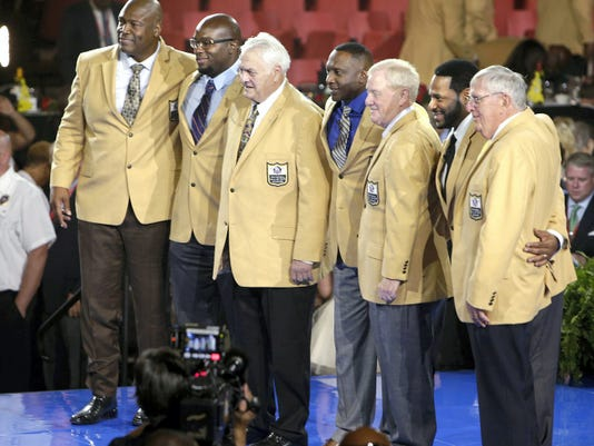 Members of the Pro Football Hall of Fame Class of 2015, left to right: Charles Haley, Will Shields, Mick Tingelhoff, Tim Brown, Bill Polian, Jerome Bettis and Ron Wolf. The group took center stage Thursday while receiving their jackets in Canton, Ohio. Class member Junior Seau was honored posthumously.