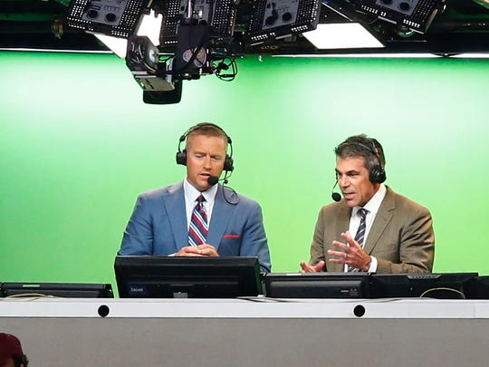 Aug 30, 2014; Arlington, TX, USA; ESPN broadcasters Kirk Herbstreit (right) and Chris Fowler announce the game with the Florida State Seminoles playing against the Oklahoma State Cowboys at AT&T Stadium. Mandatory Credit: Matthew Emmons-USA TODAY Sports