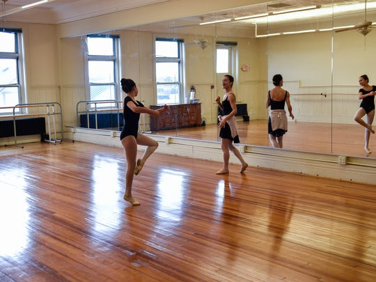 Ellen Gunn (right) works with her student, Alyssa Cohen of Holmdel, at the Monmouth Academy of Ballet in Red Bank.