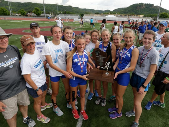 Waukesha West hoists the Division 1 runnerup trophy after tying for second with Sussex Hamilton in the 2017 state track and field meet.