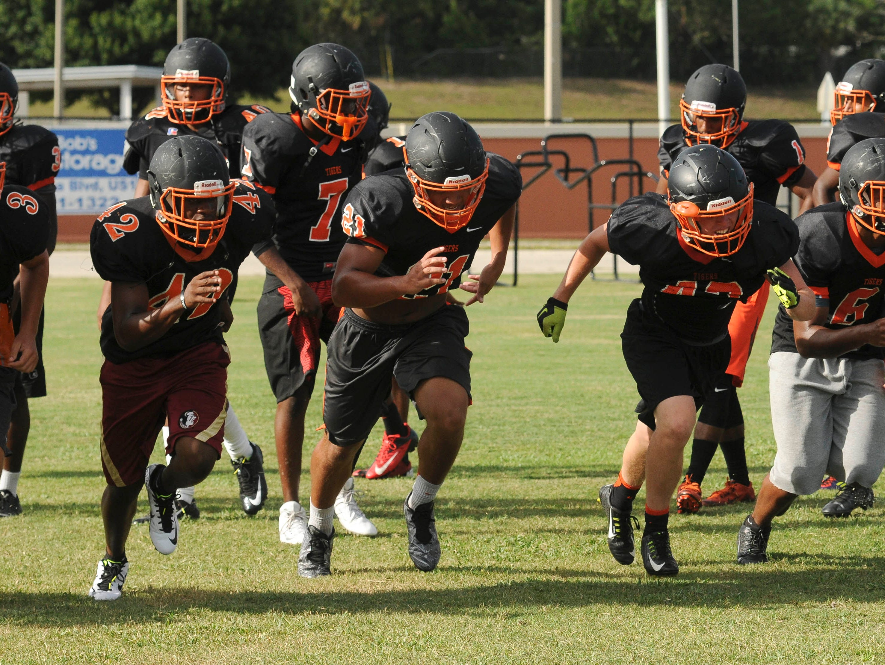 Football players at Cocoa High School run drills during practice Tuesday afternoon.