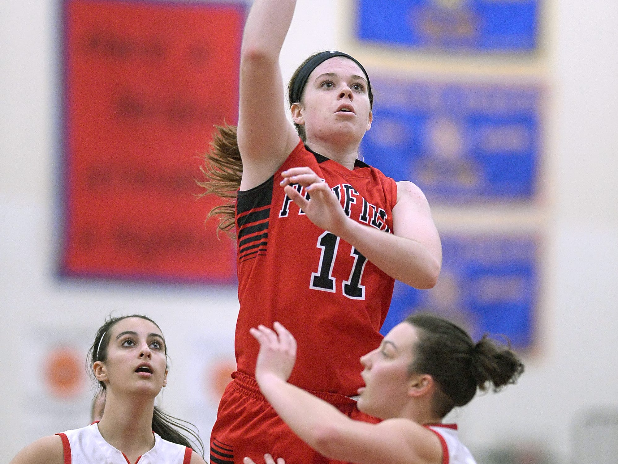 Penfield's Emma Guy shoots over Fairport's Hannah Ribble during regular season game played at Fairport High School on Tuesday.