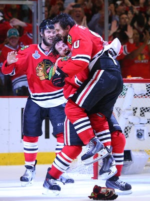 Chicago Blackhawks center Antoine Vermette (80) celebrates with defenseman Duncan Keith (2) after defeating the Tampa Bay Lightning in Game 6 of the 2015 Stanley Cup Final at United Center.