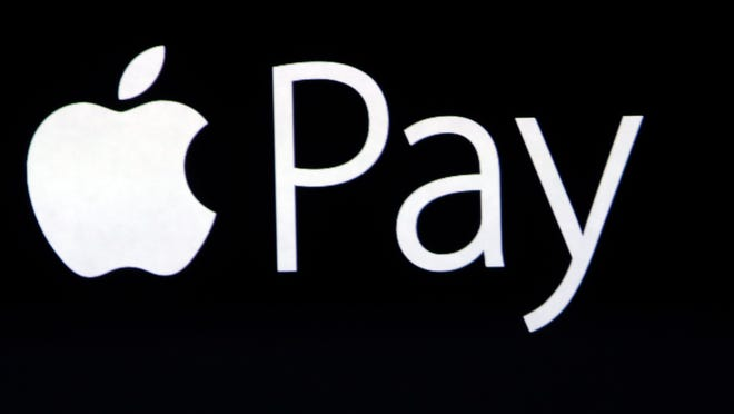 Apple CEO Tim Cook introduces the new Apple Pay product on Tuesday, Sept. 9, 2014, in Cupertino, Calif.