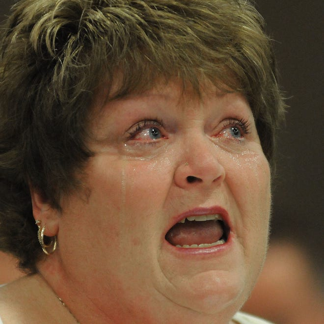 With tears streaming down her face Frieda Shade professes her innocence in Judge Jeryy Ault's courtroom on Tuesday.