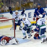 Rangers' five-game winning streak ends with 5-3 loss to Canucks