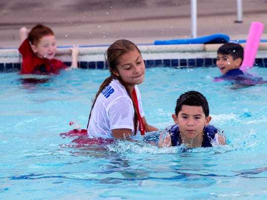 Christian Ibarra (right), 7, learns how to swim with
