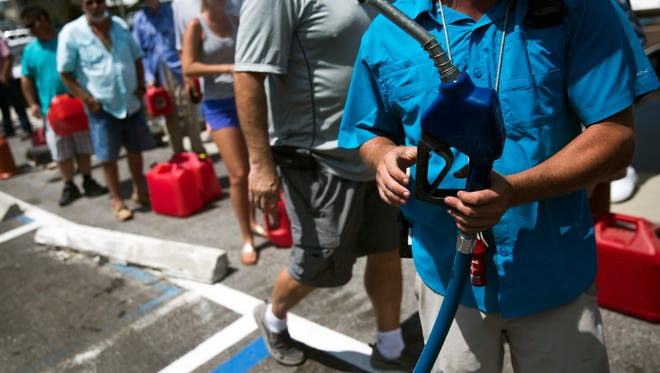 Matt Hemingway, an employee at the Rose Marina, pumps gas into county vehicles on Marco Island on Tuesday, September 12, 2017, two days after Hurricane Irma. The marina pumped gas for civilians who brought gas cans.