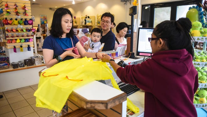 In this Sept. 9 file photo, visitors from South Korea shop at the Two Lovers' Point gift shop.