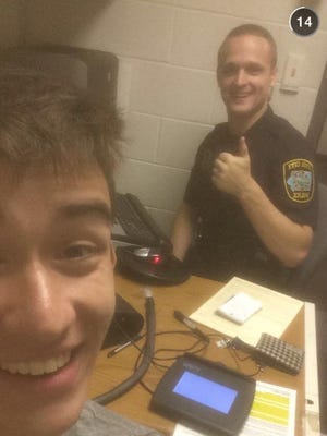 Gilbert Phelps, 20, took this selfie with Iowa City officer Ben Hektoen.