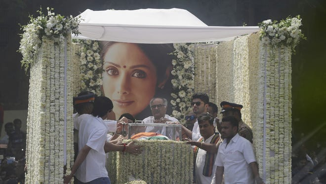 The body of Indian actress Sridevi is carried in truck during her funeral in Mumbai, India, Wednesday, Feb. 28, 2018.