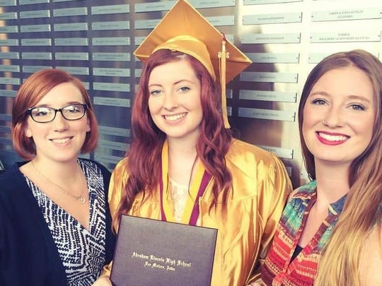 Heather Holmes graduated from Lincoln High School and is due in August with a baby girl. She is pictured with her mother and sister.