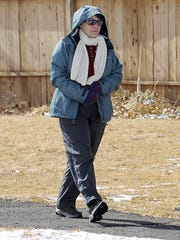 Theresa McMahon of Fernley bundled up for a chilly walk after the snow melted.
