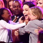 "Angelina Jolie celebrates with her children Zahara Marley Jolie-Pitt, left, and Shiloh Nouvel Jolie-Pitt at the Kids' Choice Awards.  Jolie won the award for Favorite Villain for her title role in the Disney film ""Maleficent."""