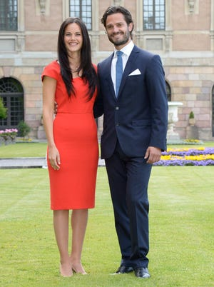 Swedish Prince Carl Philip, right, and Sofia Hellqvist, left,  when they announced their engagement at a press conference at The Stockholm Palace, in Stockholm, Friday,  June 27, 2014.