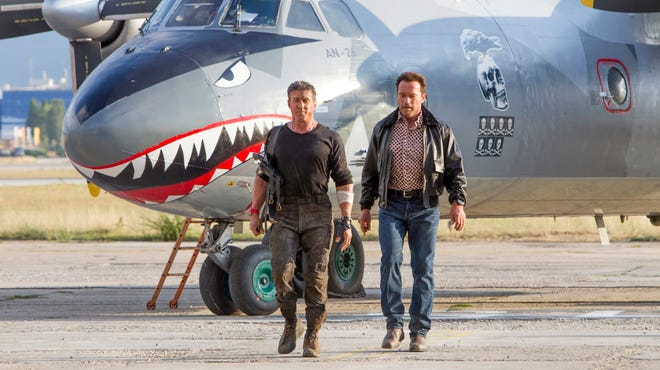 "This image released by Lionsgate shows Sylvester Stallone, left, and Arnold Schwarzenegger in a scene from ""Expendables 3."""