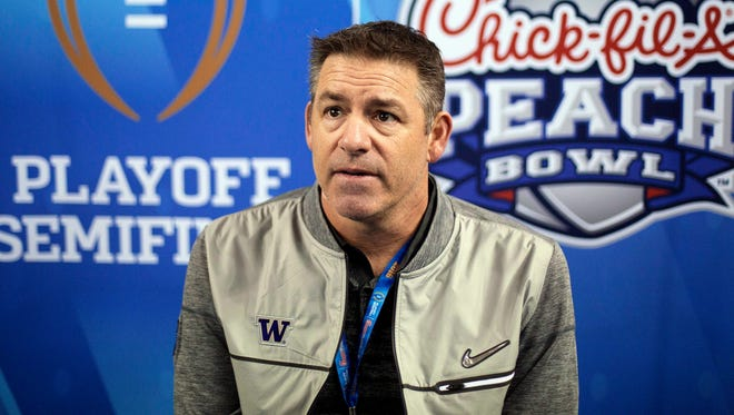 Washington defensive coordinator Pete Kwiatkowski answers a question during media day on Dec. 28, 2016, before the Huskies played in the Peach Bowl.