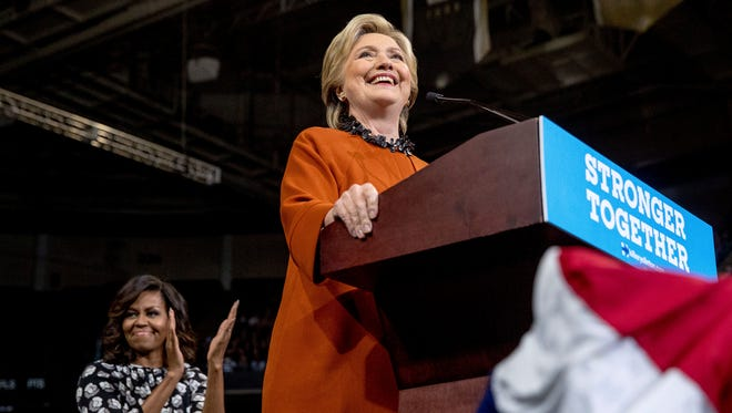 Democratic presidential candidate Hillary Clinton, accompanied by first lady Michelle Obama, left, speaks at a rally at Wake Forest University in Winston-Salem, N.C., Thursday, Oct. 27, 2016. (AP Photo/Andrew Harnik)