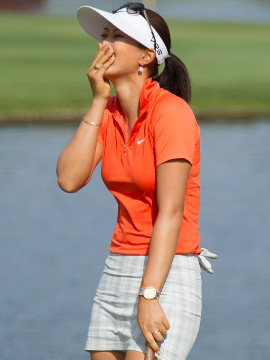 Michelle Wie reacts to winning the 2014 LPGA LOTTE Championship golf tournament on the 18th green at Ko Olina Golf Club, Saturday, April 19, 2014, in Kapolei, Hawaii. (AP Photo/Eugene Tanner)