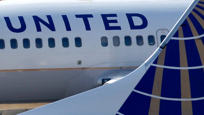 In this Sept. 13, 2011, file photo, United Airlines jets sit at Cleveland Hopkins Airport.