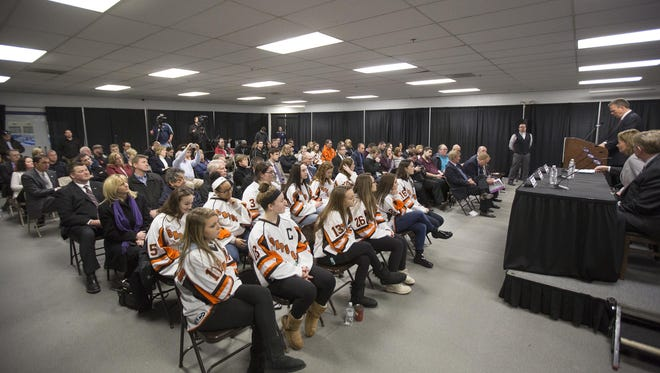 Members of the Compuware Tier 1 AAA girls hockey team (foreground) listen along with others at a February, 2016 press conference at USA Hockey Arena. The presser announced the 2017 Women's World Cup coming to Plymouth.