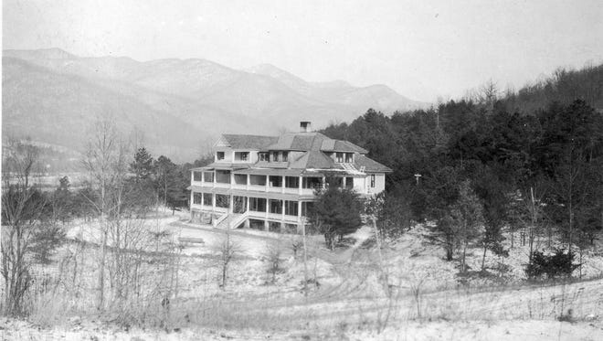 """This photograph from the Swannanoa Valley Museum & History Center's extensive collection is taken from postcard sent to Mrs. Gertrude Eldred in Loveland, Colorado on Jan. 30, 1917. As early as 1903, Kodak began producing film that would allow their customers to print a postcard from any photograph they took. The message on the back of the photograph postcard reads, """"Dear Aunt Gertrude, This is a picture that Fred took of 'The Cragmont' where we are staying for a few months. Love from Frances and Fred A."""" In 1905, the Harrison Mountain Air Sanatorium was incorporated by Dr. Isaac J. Archer of Black Mountain and Charles Piper and Wallace Harrison of Chicago in order to """"build, construct and operate a sanatorium, to care for and treat the sick..., (and) to build and operate a hotel...."""" just north of the intersection of Cragmont and North Fork Road, in the present location of Cragmont Assembly. In 1916, the company officially changed its name to The Cragmont Sanatorium, though it had used the name since at least 1908, and operated as such with  Archer as director and head doctor. The company dissolved in 1945, and the land was sold to the assembly. The building pictured here was demolished and a new building erected on the same site in 1979 for use by the assembly's conference center."""